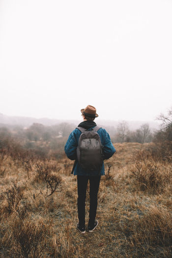 Always fun these adventures on gloomy days! | full length adult one person one man only standing casual clothing travel destinations Wanderlust tranquil scene EyeEmNewHere EyeEm Selects Hiking misty morning Netherlands foggy morning Nature rural scene Agriculture forest adventure gloomy gloomy weather Hat Backpacking backpack The Traveler - 2018 EyeEm Awards