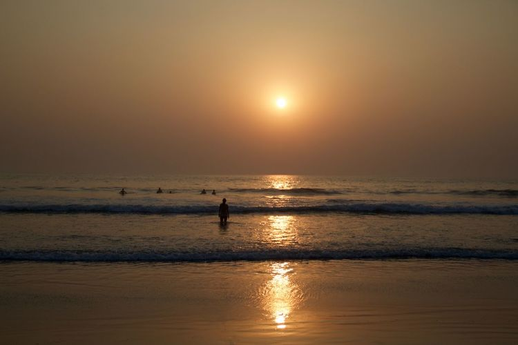 India Beach Beauty In Nature Goa Horizon Over Water Leisure Activity Nature Outdoors People Reflection Scenics Sea Silhouette Sun Sunlight Sunset Tranquil Scene Tranquility Travel Destinations Vacations Vagator Beach Water Wave Silhouette Reflection Beauty In Nature Horizon Lifestyles Nature
