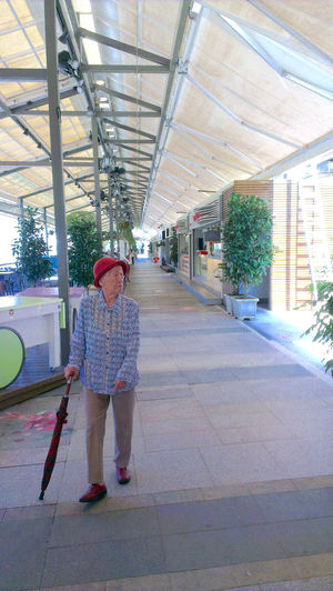 Booth Construction Site Indoors  Old Lady Old Woman Red Hat The Way Forward Vendors