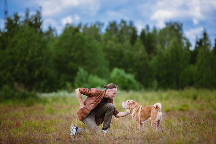 Man with dog in field