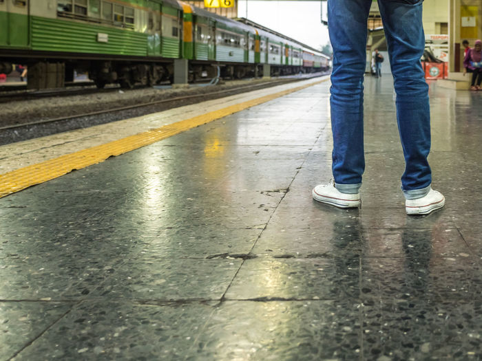 Part of man legs while stand at train paltform, in blue jean with white shoes. Passenger in railway staion at Bangkok station, Thailand. Low Section Transportation Rail Transportation Track Real People One Person Mode Of Transportation Railroad Track Body Part Shoe Casual Clothing Day Standing Jeans Railroad Station Platform Waiting Human Body Part Human Leg The Way Forward Perspective Station Train Railway Departure Platform
