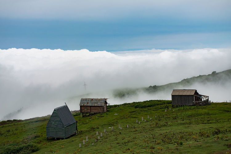 Gomismta, Georgia - village Gomismta, one of the highest villages in Gurian Region Architecture Beauty In Nature Built Structure Cloud - Sky Day Environment Field Fog Grass Green Color Land Landscape Mountain Nature No People Non-urban Scene Outdoors Plant Scenics - Nature Sky The Great Outdoors - 2018 EyeEm Awards The Traveler - 2018 EyeEm Awards