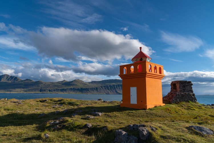 Iceland Lighthouse Architecture Beautifuliceland Beauty In Nature Belief Building Building Exterior Built Structure Cloud - Sky Day Fjord Land Landscape Mountain Nature No People Outdoors Place Of Worship Religion Scenics - Nature Sky Spirituality Tower Water