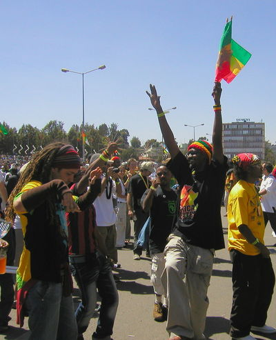 Bob Marley's 60th Brithday Celebrations Architecture Arms Raised Bob Marley Celebration City Clear Sky Crowd Day Flag Fun Happiness Large Group Of People Lifestyles Men Multi Colored Outdoors People Protestor RASTA Rastafari Real People Sky Standing Togetherness Women