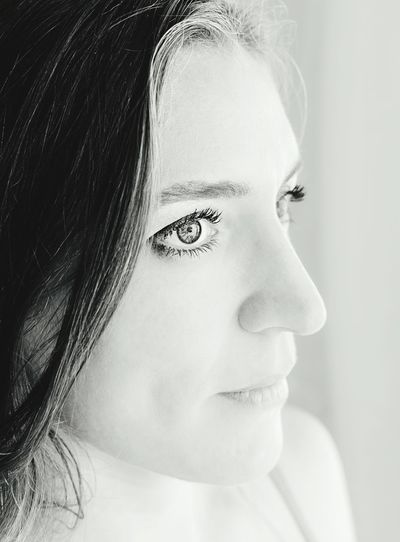 Close-up of young woman looking away at home