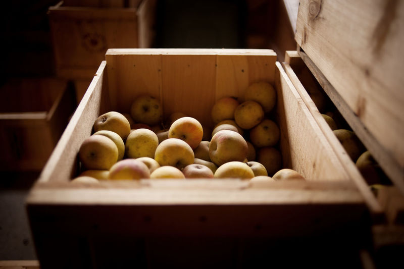 Fruits in crate at market stall