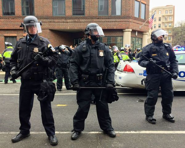 "WASHINGTON, Jan. 20, 2017 -- Police in riot gear surround detained #DisruptJ20 protesters during the presidential inauguration of Donald Trump, resulting in a mass arrest and ""felony rioting"" charges. Activism Anarchist Anti-capitalist Anti-Fascist Anti-racist Arrest Baton Black Bloc Cops Crowd Control Disrupt J20 District Of Columbia Face Visor Helmet January 20 Protests Journalists Metropolitan Police Department Militarism MPDC Police Officers President Protest Riot Gear United States Washington DC"
