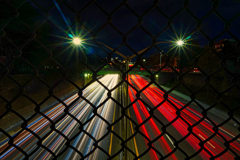 View of illuminated chainlink fence at night