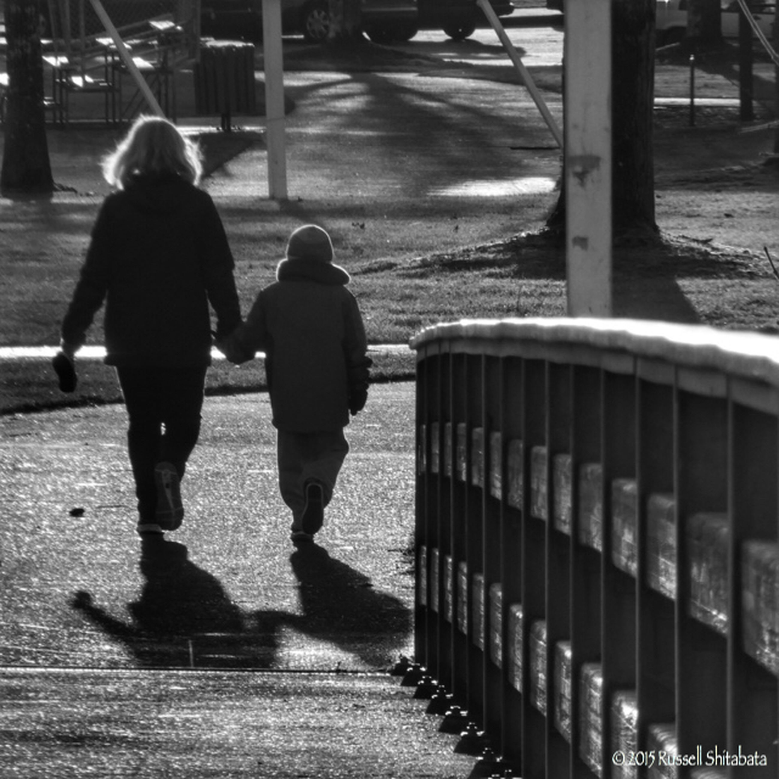 lifestyles, walking, rear view, full length, men, leisure activity, street, person, casual clothing, city, city life, togetherness, shadow, sidewalk, sunlight, standing, footpath