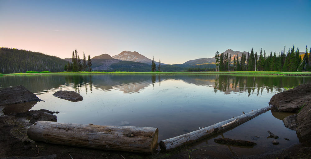 Beautiful Sparks Lake in Central Oregon sunrise tranquility serenity Bend Oregon Landscape_Collection Oregon Beauty In Nature Clear Sky Idyllic Lake Landscape Landscape_photography Mountain Mountain Range Nature No People Non-urban Scene Outdoors Outdoors Photograpghy  Reflection Scenics - Nature Sky Sparks Lake Standing Water Sunset Tranquil Scene Tranquility Tree Water Wood - Material