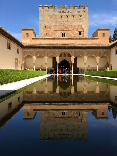 Alhambra de Granada Alhambra (Granada) Alhambra De Granada  Bow Castle Holidays ☀ Moorish Architecture Moors Castle Pond Red Walls World Heritage Cloudless Blue Sky Green Hedge Nasrid Palaces Pond Reflections Reflections In The Water Smartphone Photography Story Story Photography Town Castel