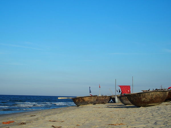 Trip in Hoi An, Vietnam August 2015. Beach Boat Boats Braided Clear Sky Flag Hoi An Hoi An, Vietnam Horizon Over Water Nutshell Boat Sand Scenics Sea Sky Sunlight Tourism Tranquil Scene Vietnam