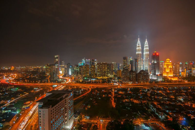 Kuala Lumpur city skyline at night Architecture Building Exterior Business Finance And Industry City City Life Cityscape Development Downtown District Financial District  High Angle View Illuminated Landmark Modern Night Nightlife No People Office Building Exterior Outdoors Petronas Twin Towers Sky Skyscraper Tower Traffic Travel Destinations Urban Skyline