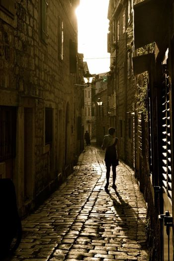 Hvar Mediterranean  Sunny Travel Alley Architecture Building Exterior City Croacia Direction Footpath Full Length Island Lifestyles One Person Paving Stone Real People Rear View Summer The Way Forward Walking