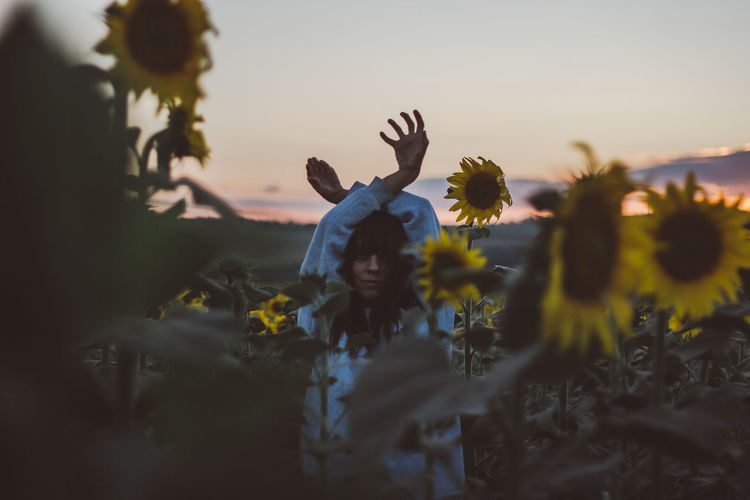 Woman Body Part Human Body Part Hand Hands Field Sunflower Sunflower Field Sky Plant Sunset Flowering Plant Real People Flower Nature Leisure Activity Beauty In Nature Lifestyles Growth Selective Focus Land People Women Human Arm Arms Raised Outdoors Child