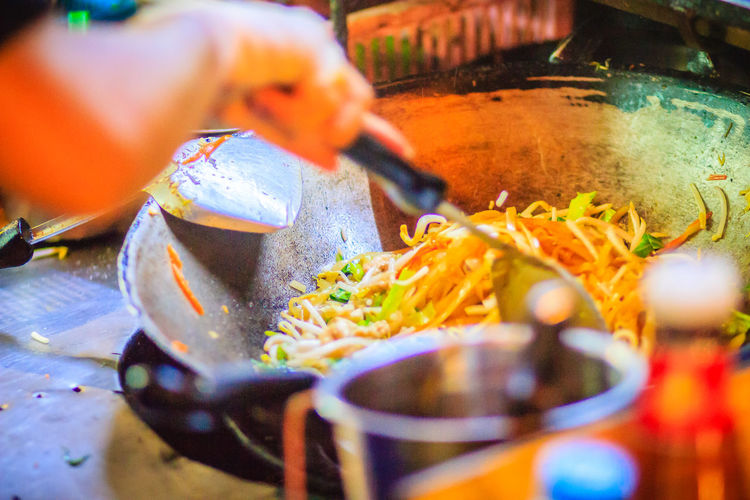 Close up hand of vendor during cooking for Padthai, the original Thai Fried Noodle, stir-fried noodle with shrimp and egg commonly served as a street food popular in Thailand Khao San Rd Khao San Road KhaoSan Khaosan Rd. Khaosandroad Pad Thai Shrimp Pad Thai With Shrimp Tourist Tourist Attraction  Tourists Asian Food Finger Food Food And Drink Freshness Hand Heat - Temperature Holding Human Body Part Human Hand Indoors  Khao San Khao San Knok Wua Khao San Rd. Khaosan Road Khaosanroad Kitchen Utensil Night Market Night Market In Thailand Night Market, Occupation One Person Pad Thai Pad Thai Kung Padthai Padthai Food Padthai Grassnoodle Preparation  Preparing Food Real People Selective Focus Street Food Street Market Tourist Destination Unrecognizable Person Working