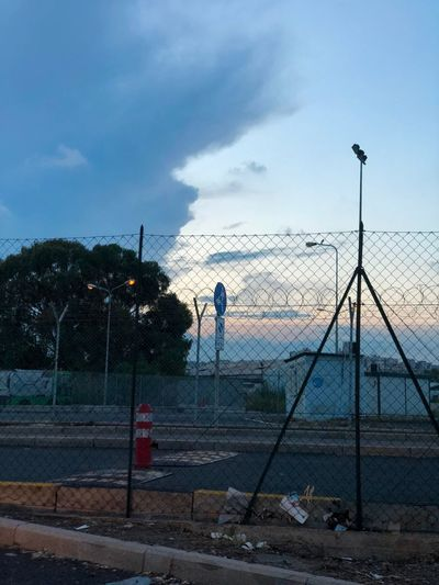 Cloudy Sunset Sky Cloud - Sky Street Nature Real People Street Light Fence Barrier Day Boundary Outdoors Standing One Person Security Safety Tree Architecture Men