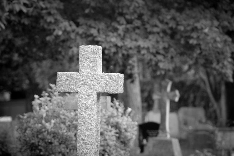 Close-Up Of Tombstones At Graveyard