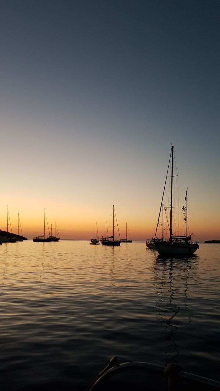 water, sunset, nautical vessel, transportation, mode of transport, tranquility, nature, no people, sea, boat, tranquil scene, beauty in nature, scenics, moored, waterfront, mast, outdoors, sailboat, sky, reflection, silhouette, harbor, horizon over water, day