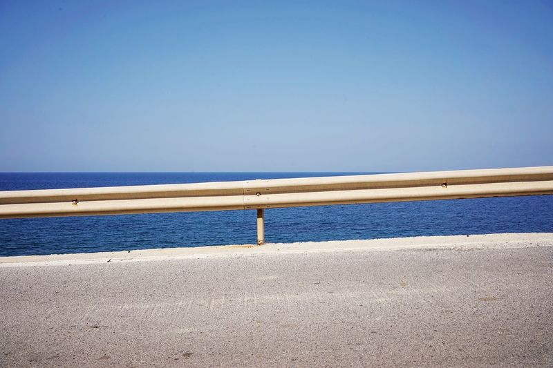 Water Sea Sky Beach Horizon Clear Sky Blue Land Tranquility Horizon Over Water Beauty In Nature Nature Scenics - Nature Day Tranquil Scene No People Railing Outdoors Copy Space