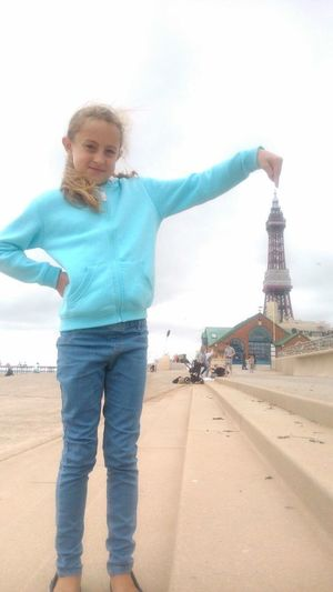 Kid touching the top of Blackpool Tower illusion Kid Child Blackpool Tower Blackpool Illusion Top Pointing Creative Photo Illusion