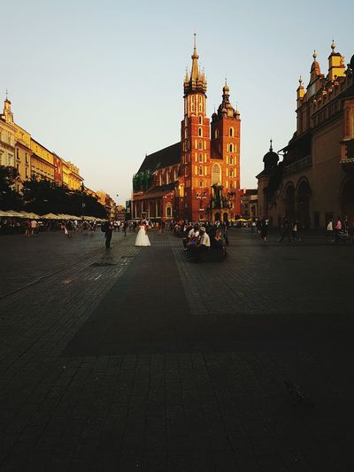 Kraków, Poland Architecture Church Cathedral Building Exterior Travel Destinations City Dusk City Life Incidental People RynekGlowny Light First Eyeem Photo