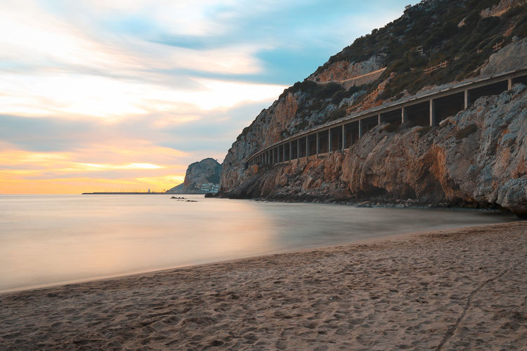 Paradise Barcelona Catalunya Mediterranean  Port Ginesta Relaxing SPAIN Beach Cataluña Horizon Over Water Nature No People Outdoors Paradise Rock Sand Scenics - Nature Sea Sky Sunset Tranquil Scene Tranquility Water