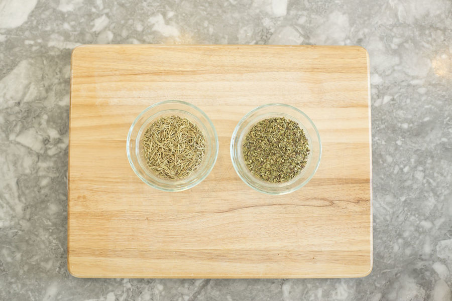 Dried herbs in glass bowls on a wooden background with space for copy. Cooking Copy Space Dried Herbs Food And Drink Herbs High Angle View Indoors  Ingredient No People Wood - Material