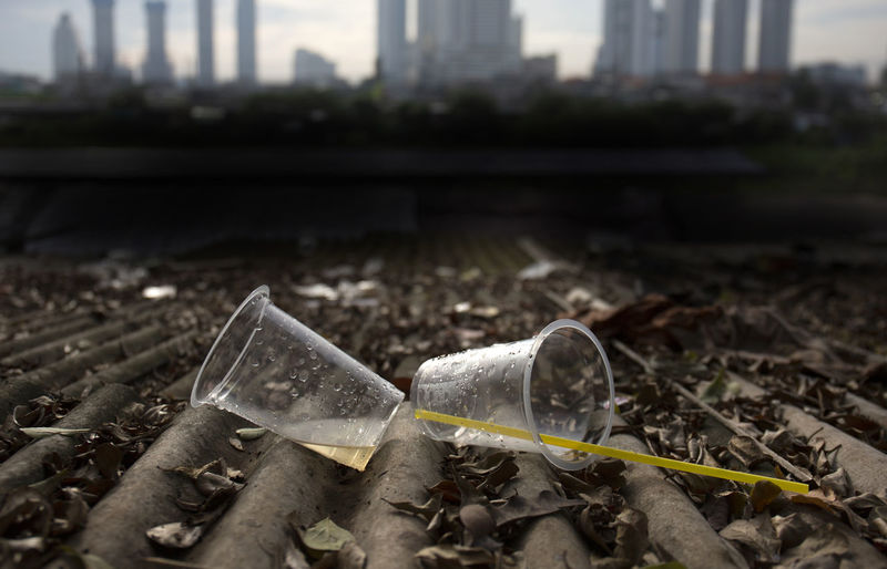 Plastic Cup Garbage Pollution Dirt Close-up No People Outdoors Dirty Architecture Focus On Foreground Plastic Environment - LIMEX IMAGINE Plastic Cup Garbage Garbage Can Environment Environmental Issues Social Issues Wet Drinking Glass Straw Color Image Photography Nature Day City ASIA INDONESIA Jakarta Cityview