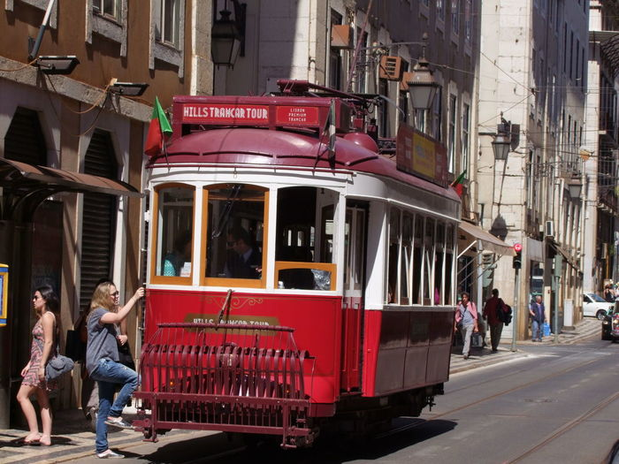 Hill Tramcar Tour Capital City City City Life City Street Composition Full Frame Fun Hop On Incidental People Information Sign Land Vehicle Lisbon Mode Of Transport Outdoor Photography Portugal Public Transportation Street Sunlight And Shadow Tour Tourism Tourist Tourist Attraction  Tourist Destination Tram Transportation