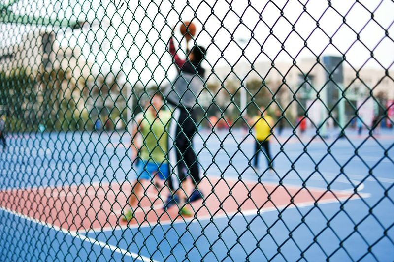 Chainlink Fence Real People One Person Outdoors People Adults Only Only Men Day Tree Young Adult Adult Basketball Close-up Basketball - Sport