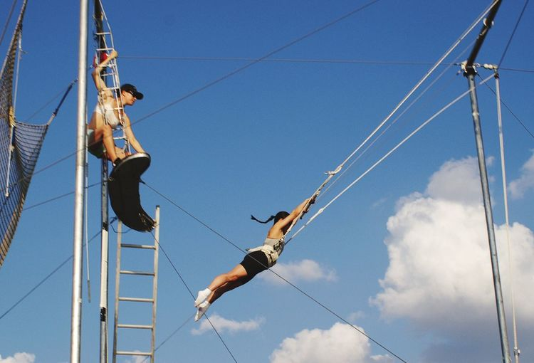 EyeEm Selects Low Angle View Rope Day Cable Sky Real People Blue Outdoors RISK Men Sport Hanging Lifestyles Full Length Extreme Sports One Person Climbing People Trapeze Artist Trapeze