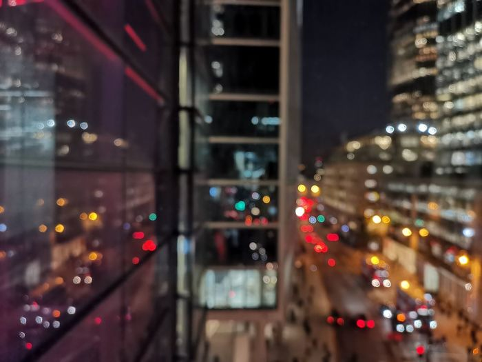 Defocused image of illuminated city street at night