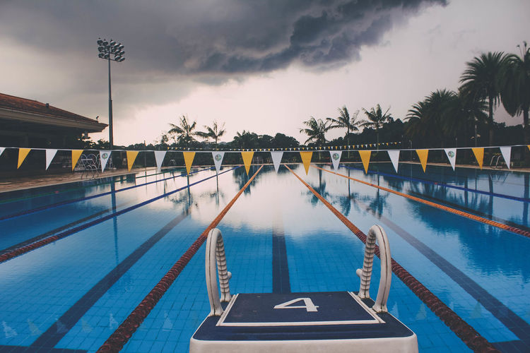 View of starting block by swimming pool