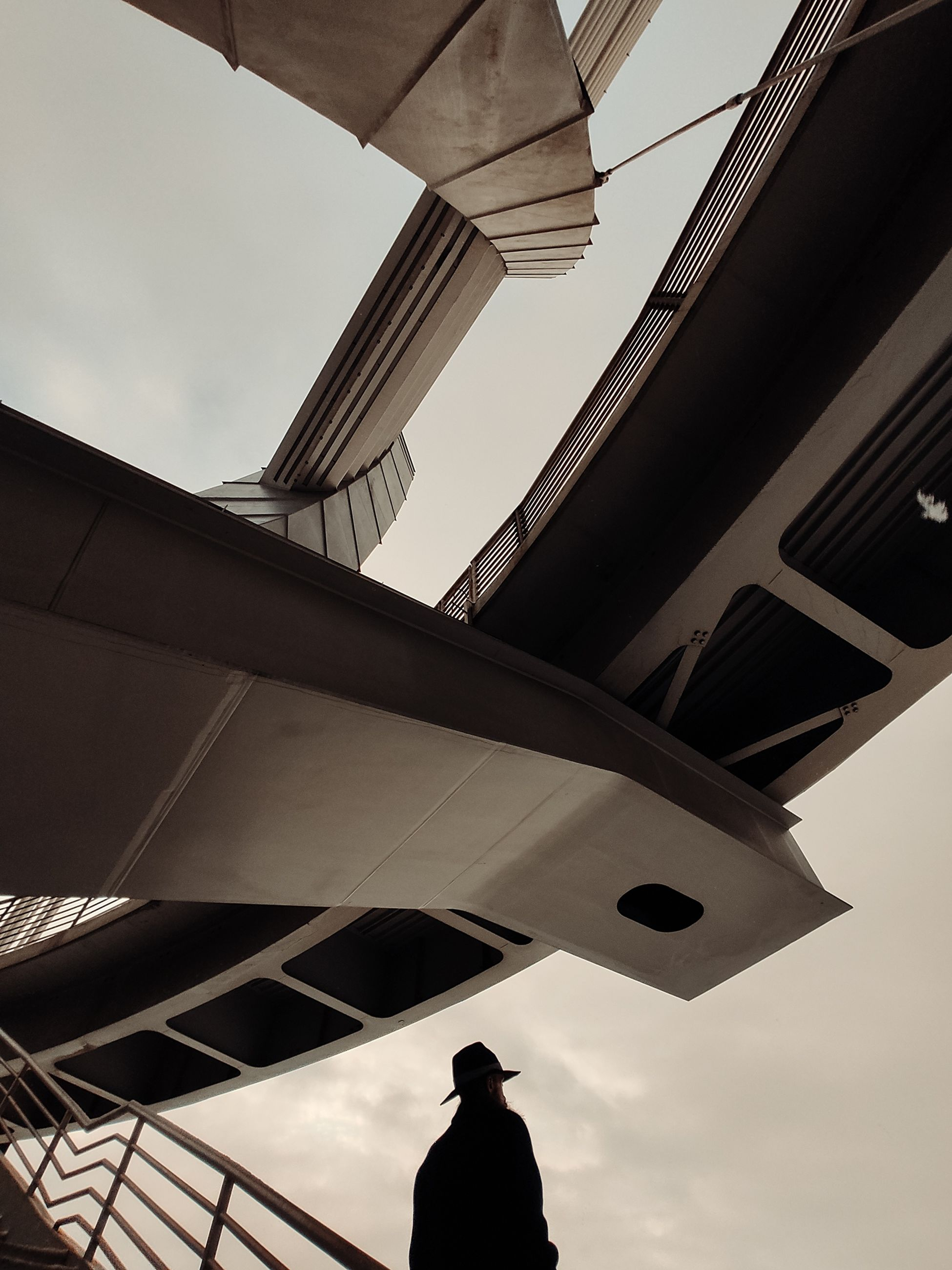 architecture, built structure, black, low angle view, silhouette, sky, clothing, adult, transportation, one person, city, person, men, white, light, travel, business, nature, building exterior, outdoors, standing, airplane