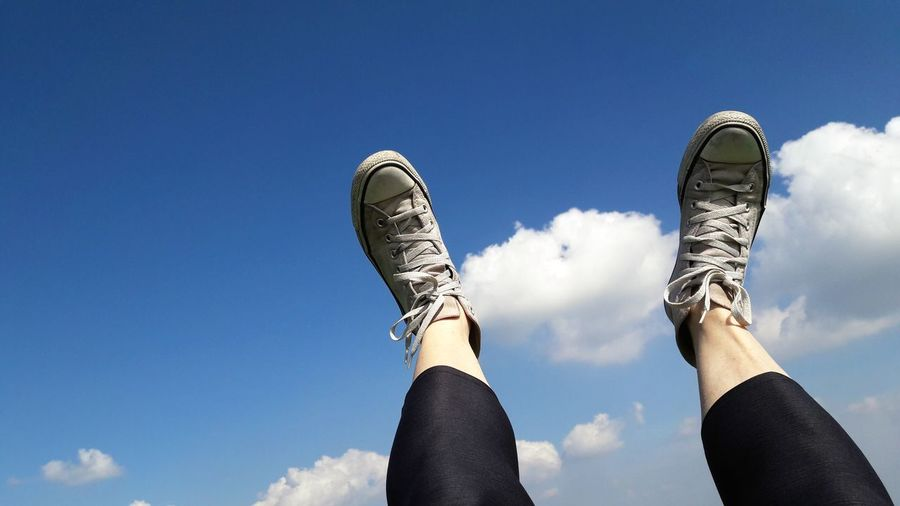 my shoes in the sky Skyporn Part Of Body My Portrait Sunlight One Person Woman Who Inspire You Low Section Athlete Blue Human Leg Sky Close-up Shoe Things That Go Together Human Foot Canvas Shoe Personal Perspective Feet Human Feet The Mobile Photographer - 2019 EyeEm Awards