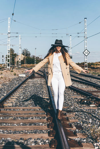 High angle view of woman standing on railroad track