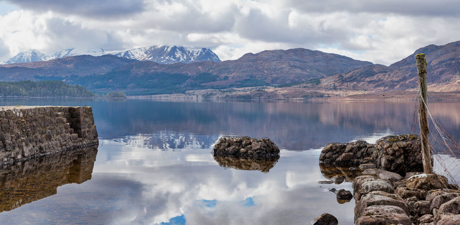 Cloudy Skies Loch Maree Scotland 💕 Day Landscape Man Made Structures In Water Mountains And Sky Naturesbeauty No People Photo Merge Photography Water Reflection Lake Calm Idyllic Dramatic Landscape Remote