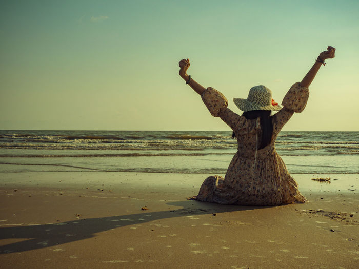 This summer, let's go to the sea. Sea Beach Sky Water Land Horizon Over Water Human Arm Beauty In Nature Sand Scenics - Nature Nature Horizon Tranquil Scene Arms Raised Tranquility Real People Clear Sky One Person Rear View Limb Outdoors
