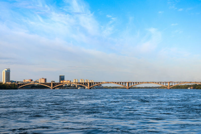 Yenisei river near the center of Krasnoyarsk Water Waterfront Sky Connection Bridge No People Cloud - Sky Bridge - Man Made Structure Day Blue Outdoors River River View Riverscape Siberia Siberia, Russia Krasnoyarsk