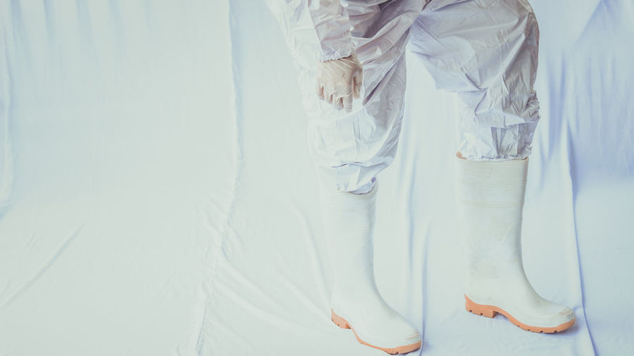 Low section of woman standing on white floor