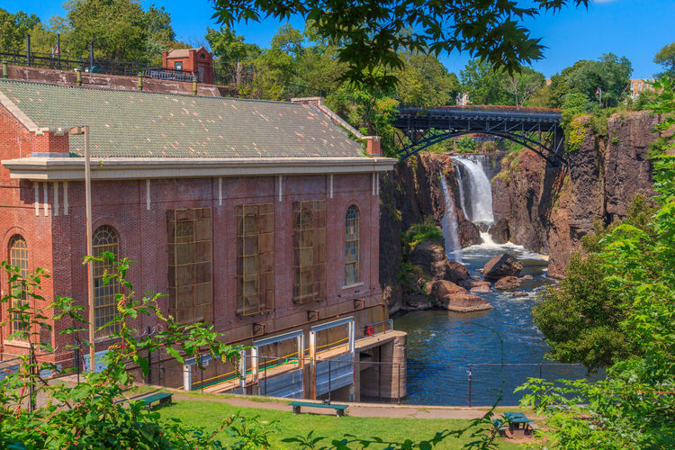 Beautiful view of Paterson's Great Falls. Architecture Bridge Building Built Structure History Hydroelectric Plant Landmark Landmarks Mill Paterson Great Falls National Historical Park Powerhouse Tranquil Scene Water Waterfall
