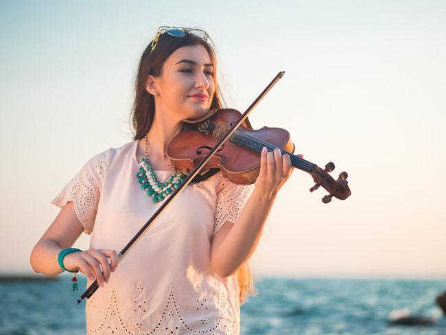 Classic Music Nature Seashore Show Woman Action Beauty In Nature Caucasian Entertainment Girl Instruments Musician Occupation Ocean Portrait Practicing Process Professionalphotography Rocks Sea Sunrise Sunset Violin Violinist