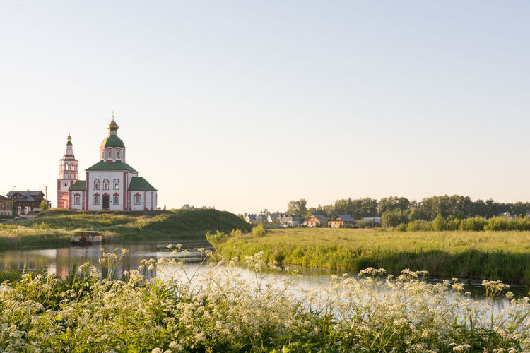 Architecture Beauty In Nature Built Structure Cathedral Church Clear Sky Grass Green Color Idyllic Landscape Nature Outdoors Plant Russia Sky Summer Suzdal Tranquility Travel Destinations