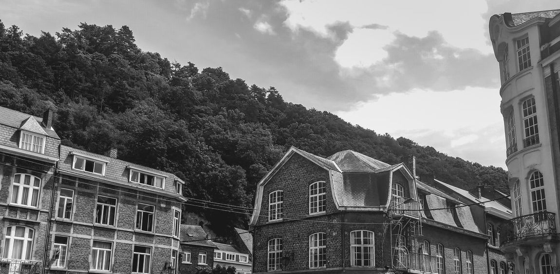 Beautiful houses in Dinant, Belgium Architecture Beauty In Nature Blackandwhite Building Built Structure City City Life Cloud Cloud - Sky Cloudy Day Houses Mountain No People Outdoors Overcast Sky Tree Weather