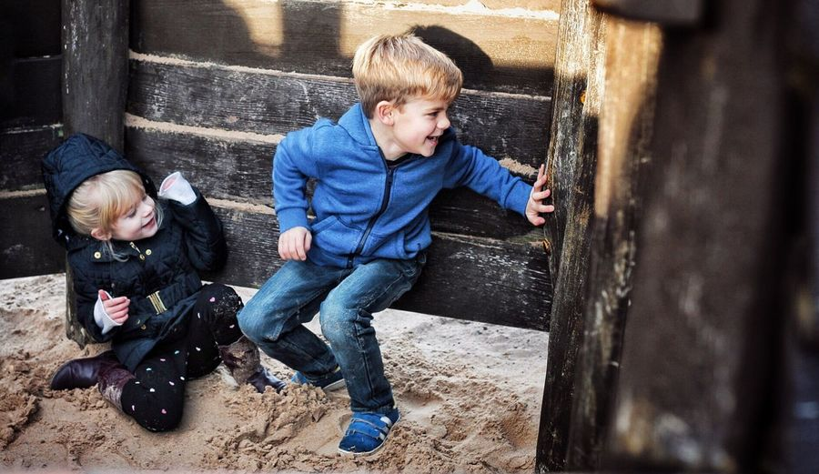 Child Childhood Outdoors Lifestyle Photography Playground Siblings Lifestyle Real People Hide And Seek Moments Fun Mischevious Playing