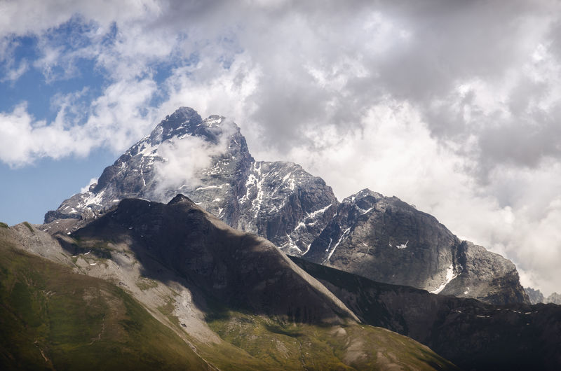 Low angle view of majestic mountain against sky