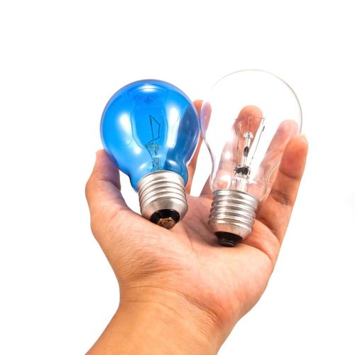 Human Hand Human Body Part Light Bulb Blue White Background Holding Inspiration Filament Technology One Person People Close-up Adult Concept Conservative Technology