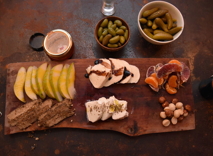 Top down view of Appetizer Platter Appetizer Appetizers Apple Bread Cheese Platter Food Fruit Grape Fruit Nuts & Seeds Pickles Platter Stock Photo Tree Fruit Wine. Top Down Food And Drink Freshness Healthy Eating Wellbeing Table No People Cutting Board High Angle View