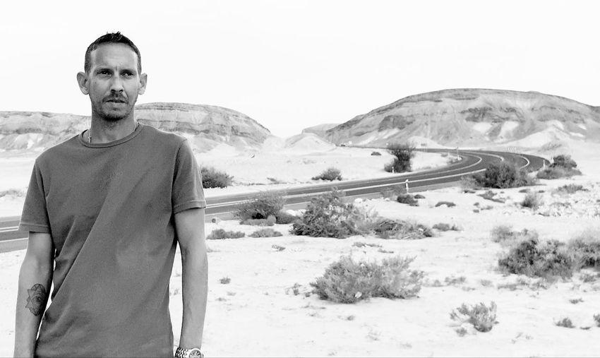 Man standing on sand at desert